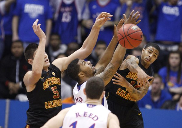 Kansas forward Markieff Morris fights for a rebound with USC players Nikola Vucevic (5) and Maurice Jones (10) during the first half, Saturday, Dec. 18, 2010 at Allen Fieldhouse.