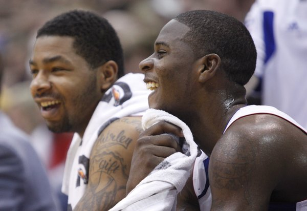 Kansas guard Josh Selby laughs with Markieff Morris on the bench during the second half, Saturday, Dec. 18, 2010 at Allen Fieldhouse.