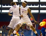 Kansas players Tania Jackson, left and Aishah Sutherland bump each other during player introductions before their game against SIU-Edwardsville Sunday, Dec. 19, 2010 in Allen Fieldhouse. The Jayhawks routed the Cougars, 91-52.