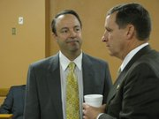 State Sen. Chris Steineger (left), R-Kansas City, Kan., confers Monday with state Sen. Dennis Pyle, R-Hiawatha, during the Senate Republican meeting in the Capitol. Steineger left the Democratic Party last week.
