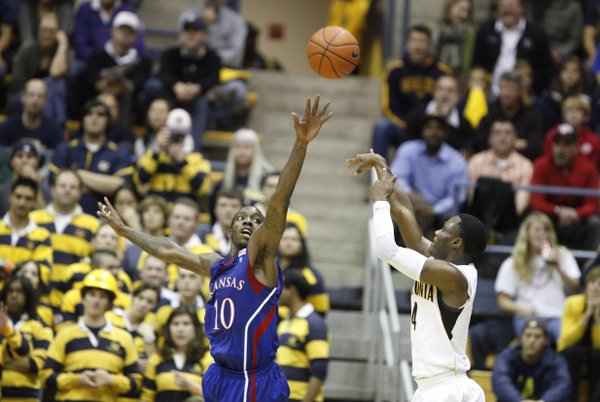 Kansas guard Tyshawn Taylor extends to defend against a shot by Cal guard Gary Franklin during the first half, Wednesday, Dec. 22, 2010 at Haas Pavilion in Berkeley, California.