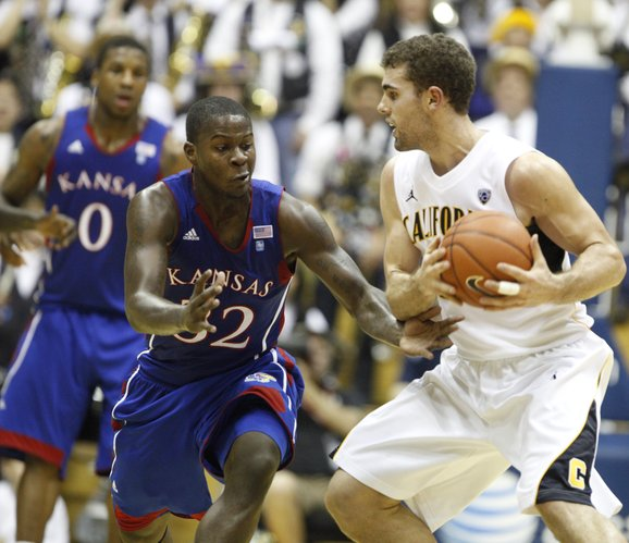 Kansas guard Josh Selby defends Cal forward Harper Kamp during the first half, Wednesday, Dec. 22, 2010 at Haas Pavilion in Berkeley, California.