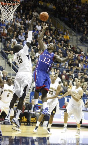 Kansas guard Josh Selby puts up a floater over Cal forward Bak Bak during the second half, Wednesday, Dec. 22, 2010 at Haas Pavilion in Berkeley, California.