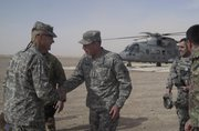 Gen. David Petraeus, second left, top U.S. and NATO commander in Afghanistan, is greeted by Brig. Gen. Skip Davis at an Italian base in Farah, Afghanistan, on Saturday.