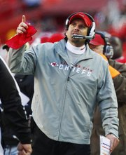Kansas City Chiefs coach Todd Haley watches a replay during the second half of an NFL football game against the Tennessee Titans at Arrowhead Stadium in Kansas City, Mo., Sunday, Dec. 26, 2010. The Chiefs defeated the Titans 34-14.
