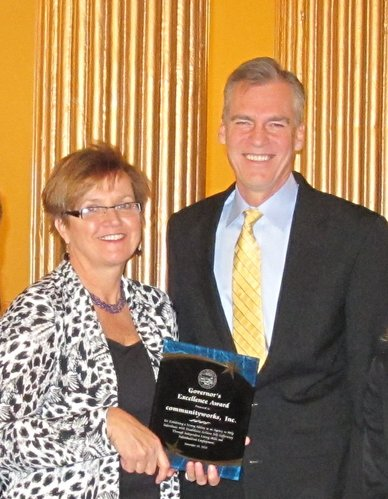 Janet Williams, founder of communityworks inc., receives the first Governor's Excellence Award from Gov. Mark Parkinson in November during a ceremony at the Statehouse.