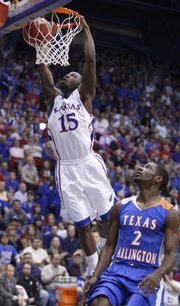 Kansas guard Elijah Johnson soars in for a dunk over UT Arlington guard Darius Richardson during the first half, Wednesday, Dec. 29, 2010 at Allen Fieldhouse.