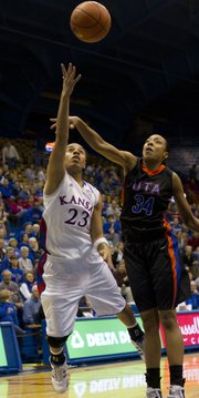 Kansas guard Angel Goodrich (23) flips up a shot under the outstretched arm of UT Arlington forward Hailee Rhymes (34) Thursday, December 30, 2010 at Allen Fieldhouse.