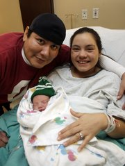 The first baby of 2011 was born to George and Vera Kodaseet, of Lawrence. The couples new baby boy is named George Jr.