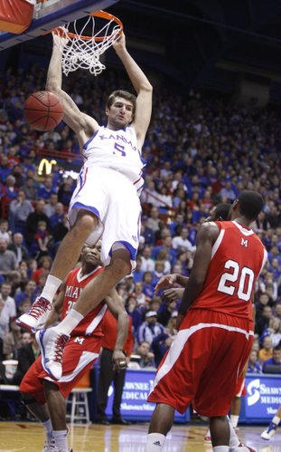 Kansas center Jeff Withey delivers on a dunk before Miami (Ohio) University forward Nick Winbush during the first half, Sunday, Jan. 2, 2011 at Allen Fieldhouse.