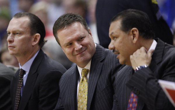 Kansas head coach Bill Self smiles as he converses with assistant coach Kurtis Townsend during the second half, Sunday, Jan. 2, 2011 at Allen Fieldhouse. At left is assistan coach Joe Dooley.