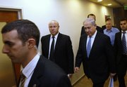 Israel's Prime Minister Benjamin Netanyahu, third left, arrives at the weekly cabinet meeting in Jerusalem on Sunday. Netanyahu has asked for nonstop, face-to-face talks with Palestinian President Mahmoud Abbas until a peace agreement is reached.