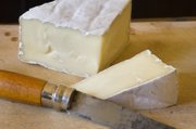 Brie is soft enough to spread on crackers, this French cheese is often what diners think of when they're told they'll be having soft cheese. The cow's milk cheese is encased in an edible rind and is similar to the camembert.