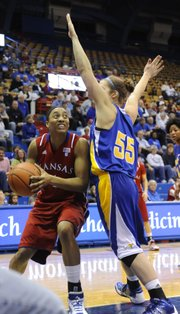 Kansas' Aishah Sutherland goes to the basket against UMKC's Kayci Boyles on Monday, Jan. 3, 2010 at Allen Fieldhouse.