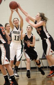 Kennedy Kirkpatrick fights for a rebound with Platte County's Taylor Johnson on Tuesday, January 4, 2011 at Free State High School.