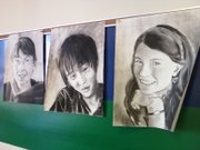 Students' self portraits await classmates, staffers and visitors inside the commons area at Bishop Seabury Academy, 4120 Clinton Parkway.