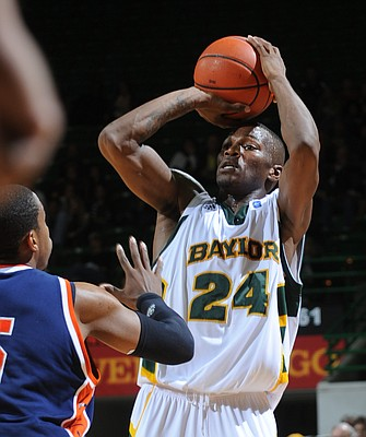 Baylor's LaceDarius Dunn, right, shoots over Morgan State's Justin Black, left, in the second half Tuesday, Jan. 4, 2011, in Waco, Texas. Dunn had 43 points including 10 three-pointers as Baylor won 89-72.