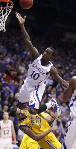 Kansas guard Tyshawn Taylor flies over UMKC guard Trinity Hall during the first half on Wednesday, Jan. 5, 2011 at Allen Fieldhouse. Hall was called for a blocking foul on the play.