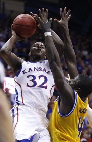 Kansas guard Josh Selby goes up to the bucket over UMKC forward Bernard Kamwa during the second half on Wednesday, Jan. 5, 2011 at Allen Fieldhouse.