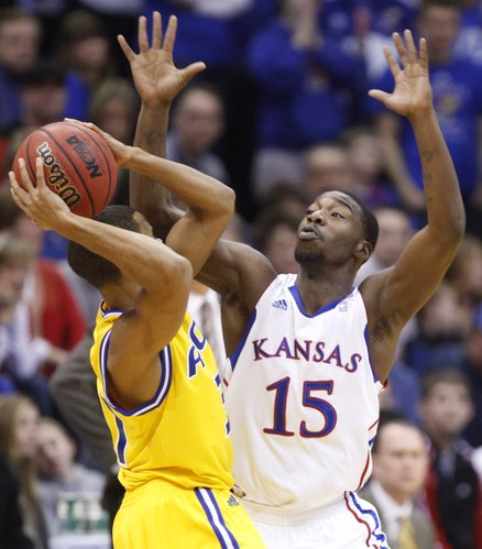 Kansas guard Elijah Johnson defends UMKC  guard Bakari Lewis during the first half on Wednesday, Jan. 5, 2011 at Allen Fieldhouse.