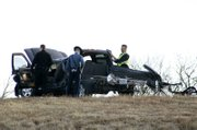 Emergency crews investigate the scene of an accident on westbound Kansas Highway 10 between Lexington Avenue and Kill Creek Road on Thursday, Jan. 6, 2011.