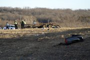 Part of a Chevrolet truck sits on the side of Kansas Highway 10 after an injury accident on Thursday, Jan. 6, 2011.