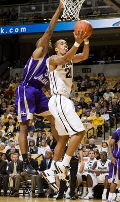 Missouri's Laurence Bowers shoots past North Alabama's Marcus Landry, left, Wednesday, Jan. 5, 2011, in Columbia, Mo. Missouri won the game, 98-58.