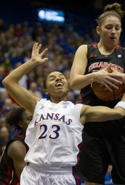 Kansas guard Angel Goodrich (23) has the ball taken away by Texas Tech guard Mary Bokenkamp during Kansas game against Texas Tech Saturday in Allen Fieldhouse.