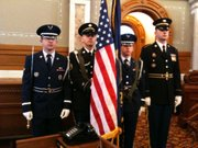 Members of the Air National Guard and Army National Guard prepare for Governor Sam Brownback's inauguration on Monday, Jan. 10, 2011.