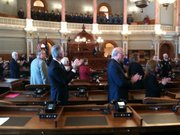 Kansas officials, including U.S. Sen. Pat Roberts, front right, applaud as Gov. Sam Brownback enters the House chamber for his inauguration on Jan. 10, 2011.