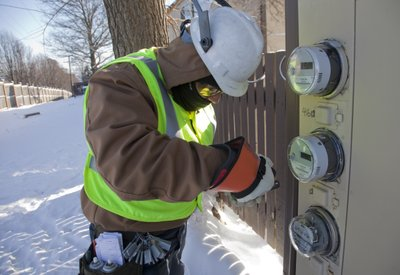 John Valdez installs Westar Energy's new SmartStar meters Tuesday, Jan. 11, 2011, at the Graystone Apartments in Lawrence.