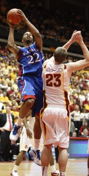 Kansas forward Marcus Morris goes up for a bucket over Iowa State forward Jamie Vanderbeken during the second half on Wednesday, Jan. 12, 2011 at Hilton Coliseum in Ames, Iowa. Morris finished with 33 points.