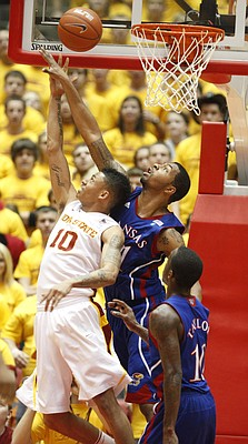 Kansas forward Markieff Morris blocks a reverse layup by Iowa State guard Diante Garrett during the second half on Wednesday, Jan. 12, 2011 at Hilton Coliseum in Ames, Iowa. In front is Kansas guard Tyshawn Taylor.