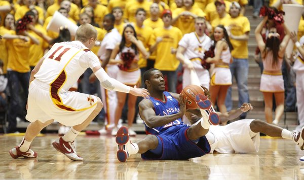 Kansas forward Mario Little looks for an outlet from the floor as he is pressured by Iowa State guard Scott Christopherson during the second half on Wednesday, Jan. 12, 2011 at Hilton Coliseum in Ames, Iowa.