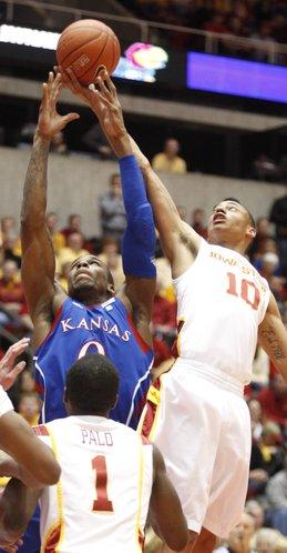 Kansas forward Thomas Robinson goes up for a rebound with Iowa State guard Diante Garrett during the first half on Wednesday, Jan. 12, 2011 at Hilton Coliseum in Ames, Iowa.