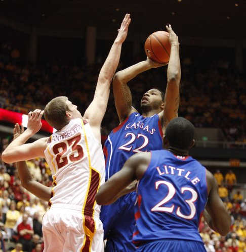 Kansas forward Marcus Morris turns for a shot over Iowa State forward Jamie Vanderbeken during the second half on Wednesday, Jan. 12, 2011 at Hilton Coliseum in Ames, Iowa. In front is Kansas forward Mario Little.