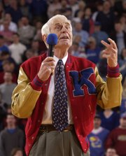 Kansas University basketball great Howard Engleman addresses the crowd with jokes and stories during halftime March 1, 2003.  Engleman, whose jersey was retired, played in for KU from 1939 to 1941.