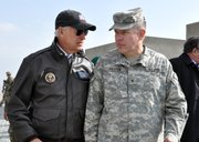 Brig. Gen. Gary Patton talks with Vice President Joe Biden about the Afghan National Army mission during Biden's visit to Kabul Military Training Center, Jan. 11, 2011.