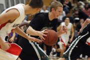 Free State's Brett Frantz drives during the first half of his team's game against Olathe North on Friday in Olathe. FSHS defeated O-North, 65-51.