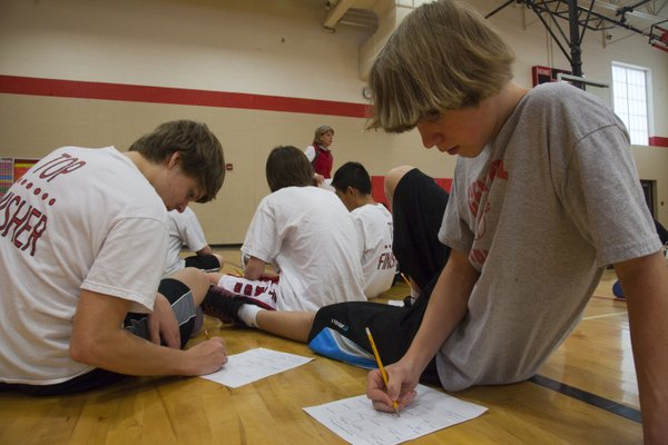Students at Central Junior High School tracked their daily activity in a week-long Pedometer Challenge. On Friday, ninth-graders Charlie Backus, left, and William Harnar completed their activity log sheets with the rest of the advanced physical education class.