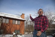 Chris Claterbos added solar panels last month to his Lawrence home after waiting nearly 24 years. The panels also have the latest solar technology. Recently covered by snow, the panels' energy output last week was small, but will increase when they can process more sunlight.