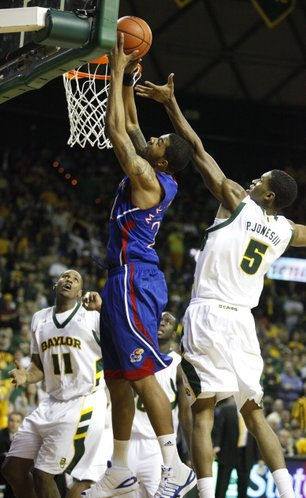 Kansas forward Markieff Morris powers in a bucket past Baylor forward Perry Jones during the first half on Monday, Jan. 17, 2011 at the Ferrell Center in Waco, Texas.