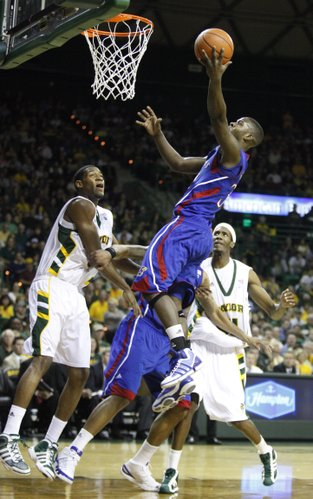 Kansas guard Josh Selby swoops in for a bucket over Baylor defenders Perry Jones, left, and Anthony Jones during the first half on Monday, Jan. 17, 2011 at the Ferrell Center in Waco, Texas.