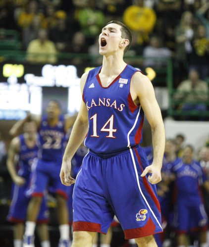 Kansas guard Tyrel Reed roars after a dunk by teammate Thomas Robinson against Baylor during the first half on Monday, Jan. 17, 2011 at the Ferrell Center in Waco, Texas.