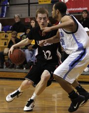 Lawrence High's Logan Henrichs (32) tries to get past a Wichita East defender. LHS lost, 50-46, on Thursday, Jan. 20, 2011 at Topeka High.