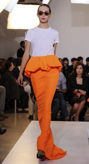 A model shows the Jil Sander Spring-Summer 2011 fashion collection. Bright clothing in more unusual, modern shapes will be in style this year.