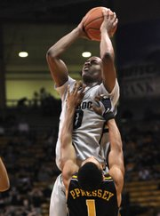 Colorado guard Alec Burks (10) shoots over Missouri guard Phil Pressey in this Jan. 8 file photo in Boulder, Colo. Burks was tapped one of The Associated Press' top sophomores in the country who have avoided second-year slumps.