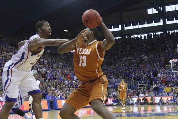 Kansas forward Markieff Morris hacks Texas forward Tristan Thompson in the first half Saturday, January 22, 2011 in Allen Fieldhouse.