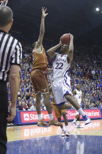 Kansas forward Marcus Morris goes up against a Texas defender on Saturday, January 22, 2011 in Allen Fieldhouse.