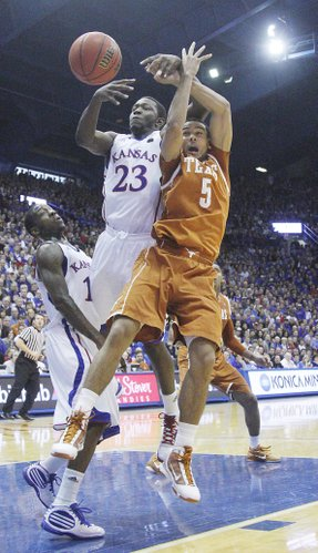 Kansas forward Mario Little fights for a loose ball with Texas guard Cory Joseph on Saturday, January 22, 2011 in Allen Fieldhouse.